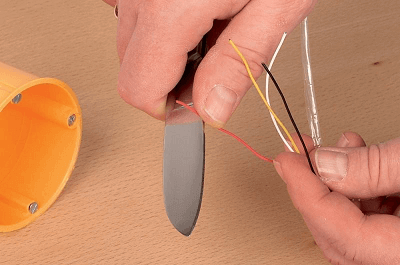 Stripping the wire with a knife